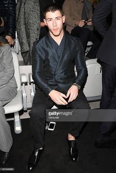 Nick Jonas attends the Emporio Armani show during Milan Men's Fashion Week Fall/Winter 2017/18 on January 14, 2017 in Milan, Italy.