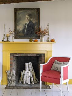 a Colorful Vermont Farmhouse Two mismatched French-style armchairs became a pair, courtesy of tomato-hued upholstery and white paint.Two mismatched French-style armchairs became a pair, courtesy of tomato-hued upholstery and white paint. Painted Fireplace Mantels, Painted Mantle, Paint Fireplace, Farmhouse Fireplace, Fireplace Surrounds, Fireplace Drawing, Brick Fireplaces, Simple Fireplace, Fireplace Ideas