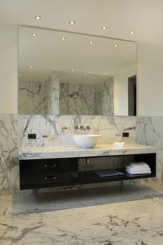 Arabescato marble has such amazing veining that needs to be seen in person. Who wouldn't want to have a marble filled bathroom?!