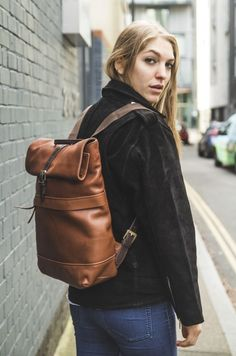 Grained Italian caramel leather with contrast straps, this roll up top backpack is a smart choice for work and college https://www.mygreenbag.co.uk/
