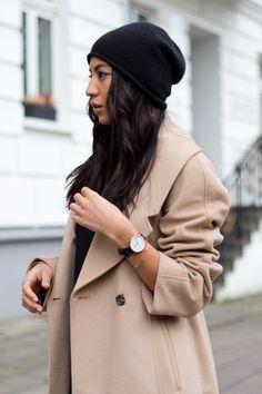 camel coat and black beanie