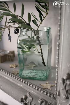 """In Provence, they display an olive branch for Christmas and New Year's as it is considered """"Lucky"""". Motif Arabesque, Chic Antique, Christmas And New Year, Christmas Ideas, Favorite Holiday, Decoration, Provence, Home Accessories, Glass Vase"""