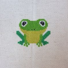 A baby frog!  #crossstitch #pointdecroix #needlework #needlepoint #embroidery #handmade #craft #frog