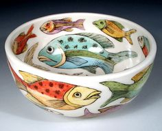This bowl contains an imaginary tropical sea where brilliant color is everywhere and no two fish are alike.