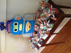 Robot birthday party favor buckets - have kids decorate their own buckets as an activity