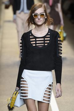 Ever chic @Fendi presents to us this caged ensemble , which we'd never want to escape from! #MFW #SS15