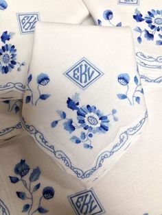 I love these blue and white monogrammed linens. They would be perfect for the mother of the bride and mother of the groom.