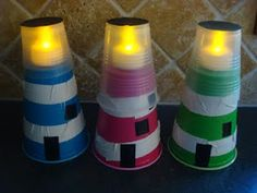 Lighthouses made from cups...lighthouse team  Materials Needed:  white plastic tape (we used white duck tape)  18 oz plastic cup  9 oz clear plastic cup  black card stock (we used construction paper for the top and black electrical tape for the door & windows)  tacky glue (we used double stick tape)  battery-operated tea light (make sure to get ones with short flames, ours were too tall)