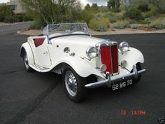 Drive or own a MG TD midget roadster