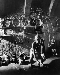 Pablo Picasso's Flashlight Centaur.  Picasso draws a picture in the dark with a flashlight and then the photographer captures the image made of light and takes a photo. black and white photographer 1949 South of France.