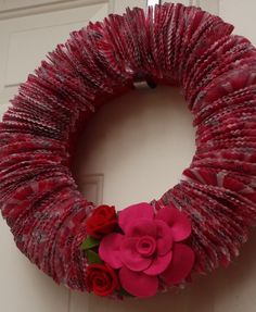 cupcake wrapper wreath-so cute and so fun for ages 4 thru ? to make for a favorite aunt, granny, or a teacher. I think it would make an adorable 'B'day cake 'plate/holder' to surround the cake  or maybe a big cupcake  and get the cupcake holders to match or blend with the icing  so fun!