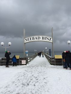 Traditional seaside resort Binz under the snow with dark and menacing clouds.