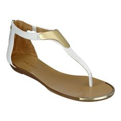 """As seen in the February issue of Marie Claire and March issue of People Style Watch.....Metal ornament thong sandal on .5"""" heel with leather upper.  Back zipper closure."""