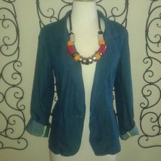 Stylish Denim Blazer This blazer is a light weight denim like material. Great with capris or a bold color mini skirt! Larry Levine Jackets & Coats Blazers