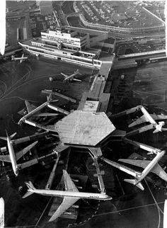 Aerial short San Francisco International  airport  United Airlines Super DC-8 (bottom of picture) Photo  ran 03/06/1967