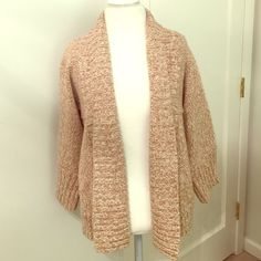 Ann Taylor Loft Sweater Like new condition; beautiful, tan Ann Taylor sweater. Loose sleeves fall right below the elbow. Size Medium. 50% Merino Wool, 50% Acrylic. Ann Taylor Sweaters Cardigans