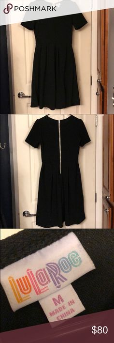 Final price drop! NWOT solid black Amelia Super stretchy material! The perfect little black dress! LuLaRoe Dresses