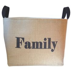 Stow extra blankets in the living room or entertainment accessories in the den with this burlap and canvas storage basket, showcasing a charming typographic ...