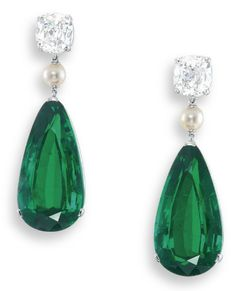 A MAGNIFICENT PAIR OF EMERALD, DIAMOND AND PEARL EAR PENDANTS  EACH SUSPENDING A PEAR-SHAPED EMERALD WEIGHING APPROXIMATELY 23.34 AND 23.18 CARATS, SPACED BY A PEARL, TO THE CUSHION-SHAPED DIAMOND SURMOUNT WEIGHING APPROXIMATELY 3.01 AND 3.01 CARATS, MOUNTED IN PLATINUM, 4.5 CM LONG