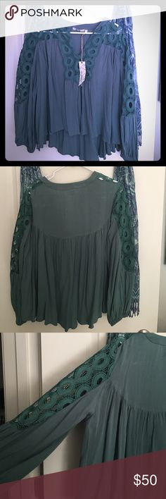 Teal shirt from the Buckle This blouse is brand-new, very flowy, teal and from the Buckle BKE Tops Blouses