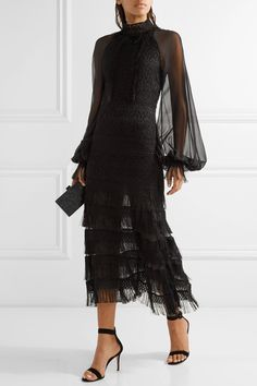 JONATHAN SIMKHAI Fringed silk chiffon-paneled guipure lace midi dress $1,495 Known for his architectural silhouettes and striking embellishments, Jonathan Simkhai launched his first eveningwear line for Resort '17. Cut from intricate guipure lace, this tiered midi dress has billowy silk-chiffon sleeves and swishy fringed trims. Style yours with sleek black accessories.   Shown here with: Edie Parker Clutch, Gianvito Rossi Sandals, Maria Black Rings.