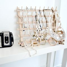 Sewing spool rack turned jewelry organizer - from Easy Organizing Ideas for the Home