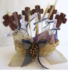 Create your own centerpiece with these chocolate crosses.  They will also serve as party favors. http://www.cool-party-favors.com/candy-communion-favors-chocolate-pop.html