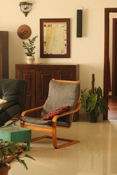 The two wooden furniture the poang chair and footstool, hat on the wall, map frame and green plant at the corner of the room | Home Tour: A beautiful Antique Modern home in Bangalore ~ The Keybunch Decor Blog Makes You Beautiful, Beautiful Homes, Brick Cladding, Vintage Trunks, Stone Flooring, Decorating Blogs, Wooden Furniture, House Tours, Map Frame