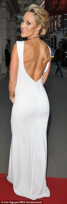Winning in white: Caroline looked delightful in a floor-length white dress which featured ...