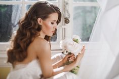 Adorable young bride holds a bouuqet of peonies siting on the windowsill in the bright morning Paris Destination, Destination Wedding Planner, Wedding Flower Inspiration, Wedding Flowers, Wedding Dresses, Paris Wedding, Wedding Day, Mom Daughter, Wedding Events