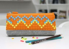 Pixel Craze - Design Your Own Pencil Case. A colourful and funky pencil case that is the perfect back to school accessory for those who like something a little different! Customise and design your pencil case cover over and over again and be the coolest kid in school with our pixel pencil case!