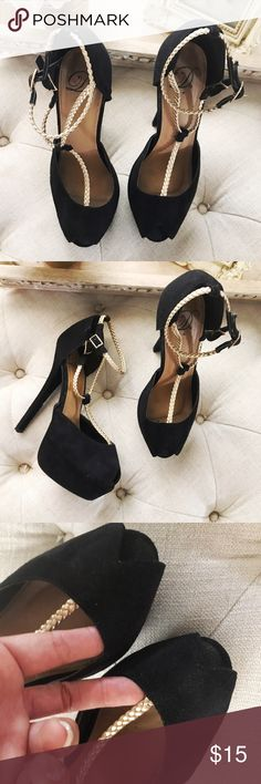 Black and gold peep toe Platforms Excellent used condition beautiful black and gold T-strap suede Platforms. Used lightly no tears or scratches. Can be worn so many ways. True to size. Matches perfectly with any of the black tops in my shop bundle for 15% off. Shoes Platforms