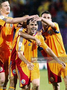 Cosmin Contra (C) from Romania is congratulated by his team mate after he scored 2-0 against Slovenia during the EURO 2008 Group G qualification match in Timisoara, 600km west from Bucharest, 06 June 2007.
