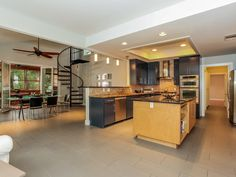 Excellent combination of kitchen/dining, getting rid of the wasted space of a formal dining room.