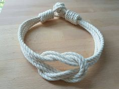 Cotton rope small double square knot curtain tiebacks.  Ivory/ Old white  Cotton rope - 3 Strand construction. Soft to touch, will not shrink or swell when wet.  The tiebacks do not need any wall fittings they wrap around curtains.   Various sizes available.  Knot size 2 x 4   Care Instructions : W