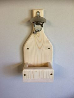 Wall mounted bottle opener with top catcher