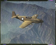 """P-51 'Mustang' fighter in flight. Inglewood, California, October 1942. Reproduction from color slide. Photo by Alfred T. Palmer. Prints and Photographs Division, Library of Congress"" (Denver Post)"