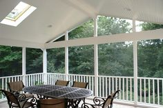 white screened porch interior - beadboard ceiling & skylights