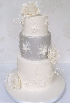 Brides.com: Beautiful Wedding Cakes for Every Season. Romantic Peony and Lily of the Valley Wedding Cake. This wedding cake comes to us all the way from the United Kingdom. Pastry chef Helen Mansey, owner of Bellissimo Cakes, in Liss, sent over this elegant white-and-silver wedding cake. The embellishments on the tiers were inspired by a lace wedding gown; Helen used hand-piping and brush embroidery techniques to replicate the look. For a unique twist, she decided to give the cake a silver…