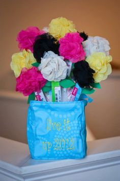 Tip of the day - Create a bouquet of nail files and rosette clips to use as door prizes at shows.