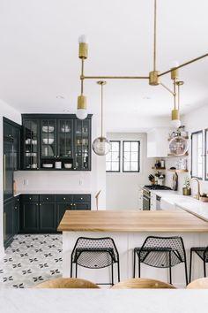 brass black and white tile kitchen