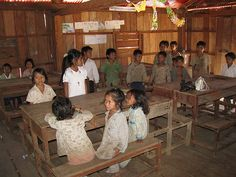 Classroom photo by Flickr user Charles Pieters.  United World Schools (UWS) is a NGO that helps to build schools in remoted areas in Ratanakiri. The villagers themselves make the construction. http://www.unitedworldschools.org/