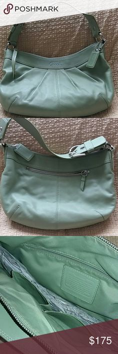 New Authentic Coach rare seafoam green purse Authentic Coach bag in a beautiful and rare to find Seafoam green color leather, one exterior zipper pocket, one interior zipper pocket, two small side pockets. All working zippers. New, bought it while traveling for my mom and she said it was not her style preference. Coach Bags Hobos