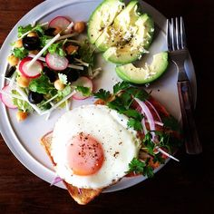 I can't get enough of these breakfasts: avocado, egg on toast, radish salad.