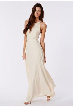 Channel your inner enchantress in this beautiful flowing open back maxi. With delicate straps and ribbon and lace detail, this really is an Oscar winning piece. Wear with matching shoes and a tiny box clutch and you'll be ready to collect y...