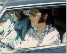 Elvis and John O' Grady leave Elvis' Hillcrest home in his Stutz Blackhawk : October 9, 1970.