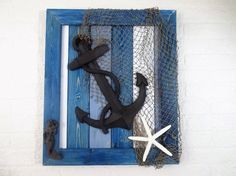 """Nautical Cast Iron Anchor Beach Cottage Wall Decor. Please note that each of our items is hand made and made to order. there is currently a 7 day shipping time on all items with the exception of cabinet knobs. Each item ordered from Twisted R Design is created in the order we receive the orders. 24""""x21"""" frame wall décor constructed of sanded pine wood finished with wood stain in shades of blue, white and gray and sealed with a clear coat. The colored stains that we use allow for a…"""