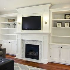 White built-ins around fireplace in family room with updated brick/tile and large white mantel. TV mounted above fireplace. Bookshelves Around Fireplace, Tv Above Fireplace, Fireplace Built Ins, Home Fireplace, Fireplace Remodel, Fireplace Surrounds, Fireplace Design, Fireplace Ideas, Farmhouse Fireplace