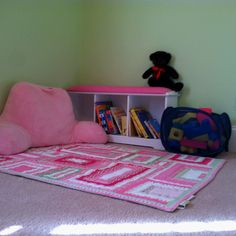 Use crib blanket to create reading and play center. Plan ahead and choose a theme that will transition from nursery to big kid.  Girls room - boys room - toddler