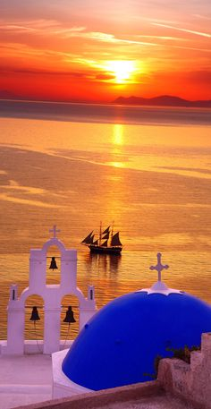 Amazing Santorini sunset with churches and sea view in Greece